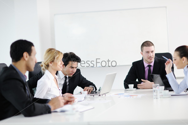 Group of young business people at meeting
