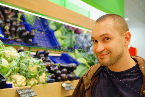 smiling man in supermarket