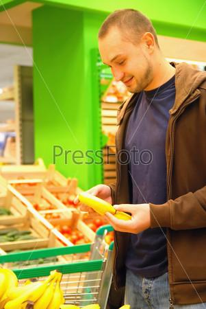 smiling man in supermarket