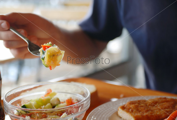 man eating healthy food it an restaurant