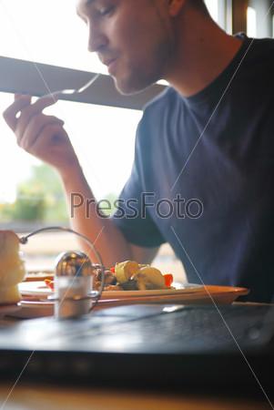 man eating healthy food it an restaurant