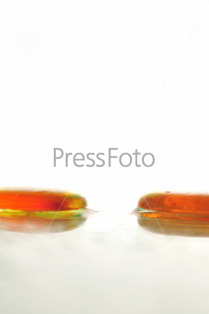 isolated wet zen stones with splashing  water drops