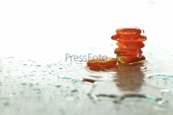 isolated wet zen stones with splashing  water drops