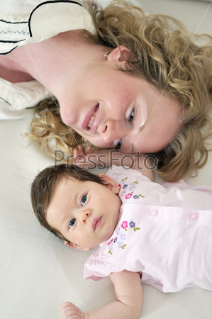 beautiful young mother small with little baby