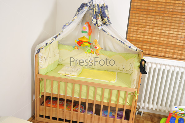 baby bed with colorful toys indoor