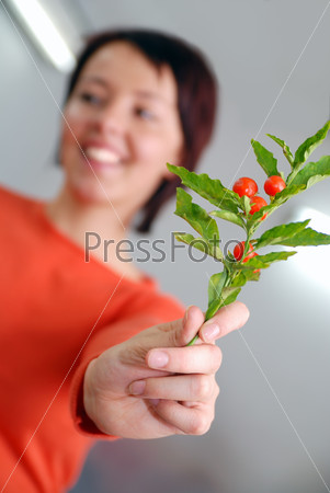 Beautiful  girl holding young plant