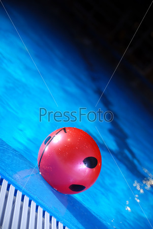 .red ball in swimming pool
