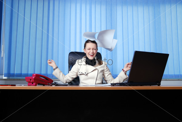.happy businesswoman throwing papers in air