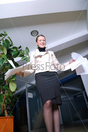 .happy businesswoman throwing documents