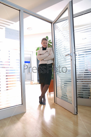 young businesswoman posing in office | new perspecitves concept