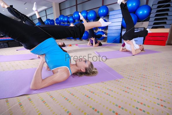 health club: women doing stretching and aerobics