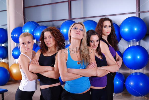 girls team in a fitness center