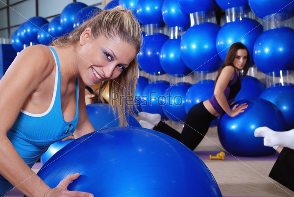 beautiful young girls working out in a gym