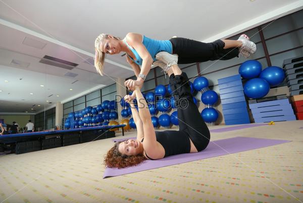 Flexible girls in fitness studio