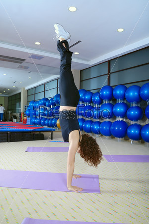 Pretty girl exercising in a fitness studio