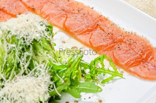 Fish Carpaccio with salad