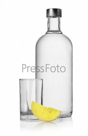 Bottle of vodka and lemon isolated
