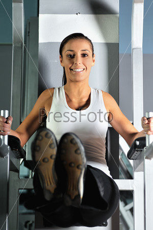 young woman practicing fitness and working out
