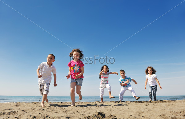 happy young  people group have fun on beach