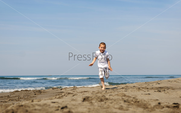 little boy running on beach