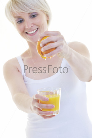 Young woman squeeze orange juice