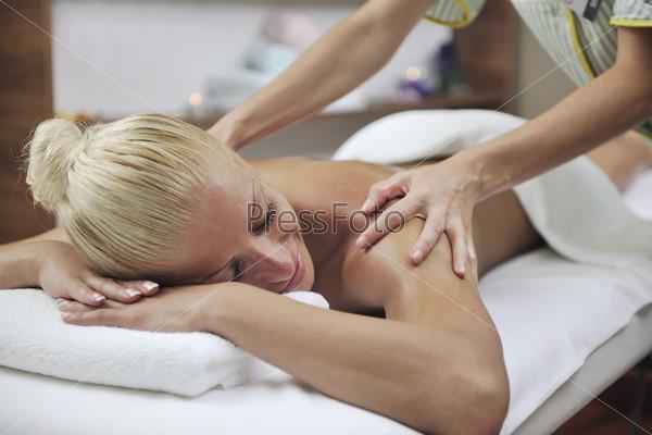 woman at spa and wellness back massage