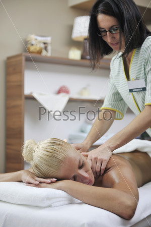 woman at spa and wellness back massage