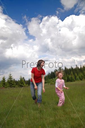 happy girls running in nature