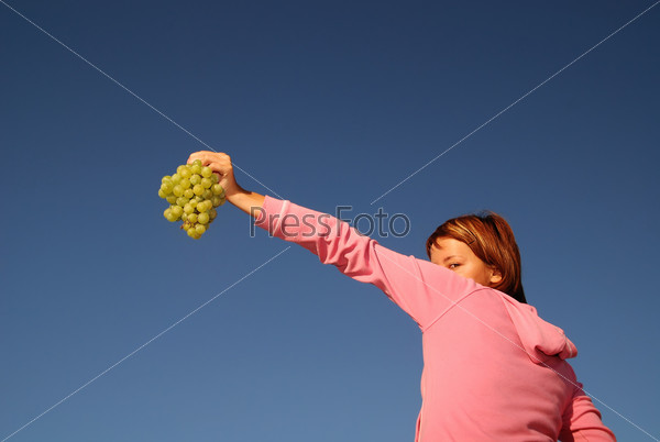 girl with grape outdoor