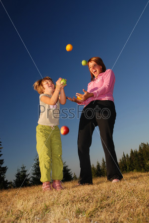 Food balancing concept with girls in nature