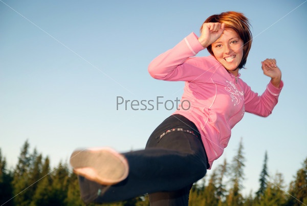 pretty girl doing exercise in nature