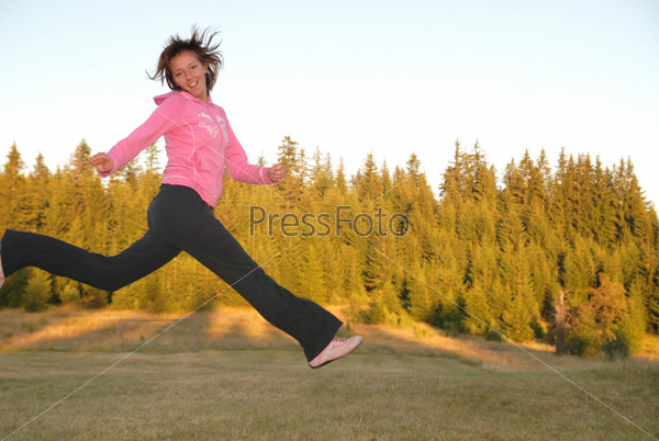pretty girl jumping in a air