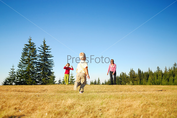 mother and kids having fun outside