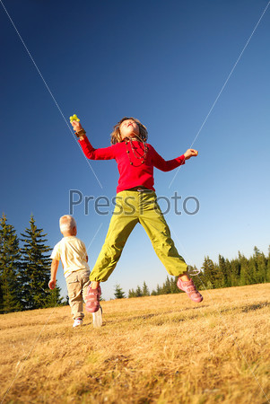 happy child jumping in nature