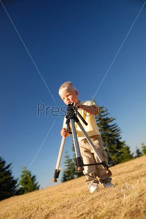 little boy with tripod