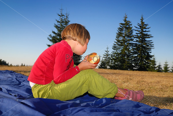 the girl eating apple in nature