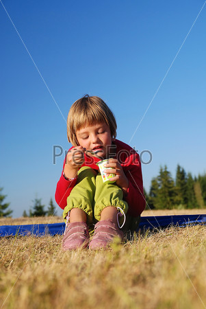 cute little girl eating healthy food outdoor