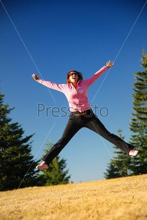 pretty girl jumping in a air