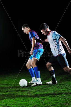 football players in competition for the ball