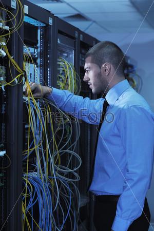 young it engineer in datacenter server room