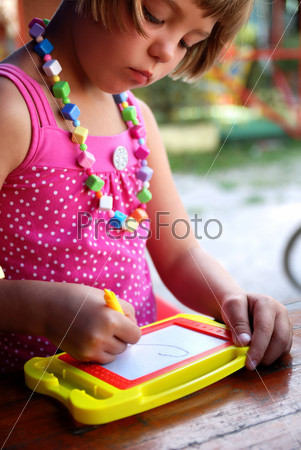 Cute litlle girl drawing