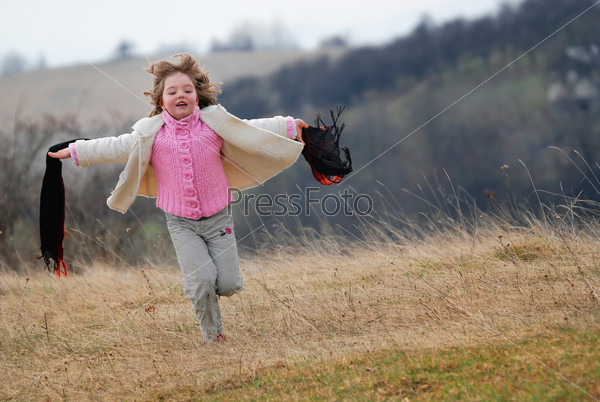 beautiful running girl on meadow  with wind in their hair