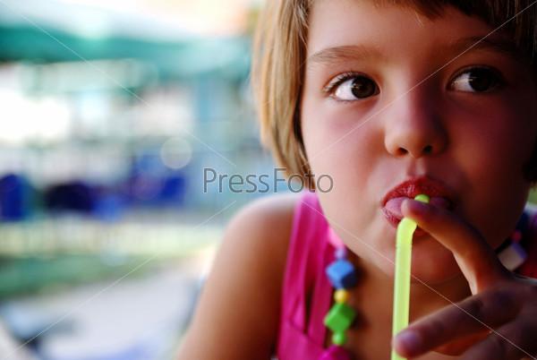 Cute little gilr enjoying cold drink