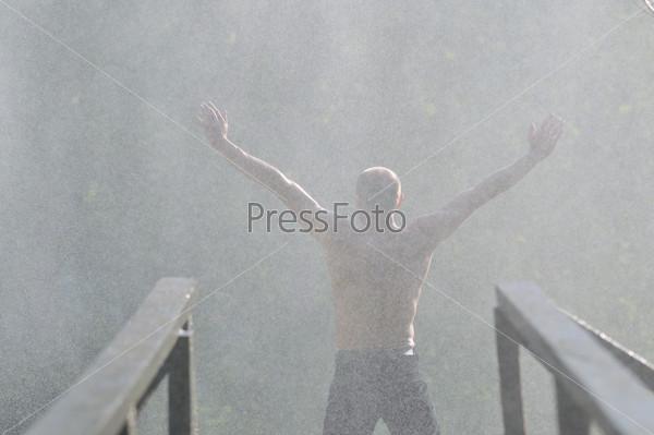 man waterfall