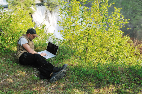 man outdoor laptop