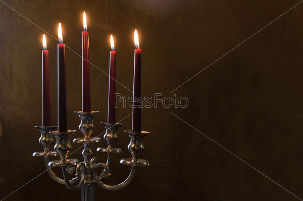 Five red candles lighted on painted room