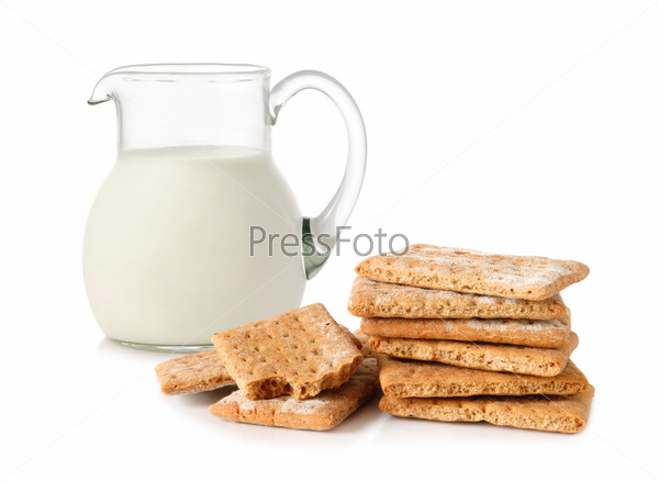 Glass jug with milk and cracker