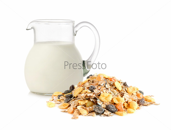 Glass jug with milk and muesli