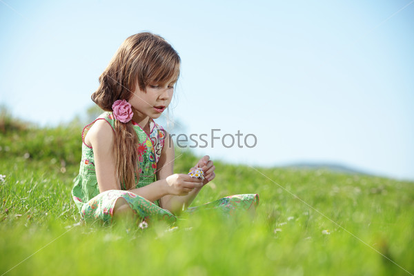 Little girl at green field
