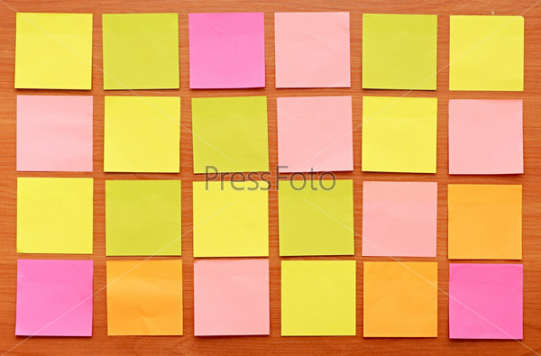 colorful notes on a wooden background